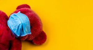 Mask on red teddy bear